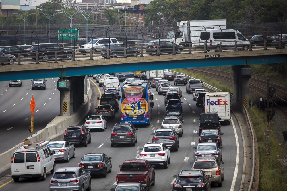 The Friday evening commute begins as cars jam up on the Mass. Pike and on the overpass on Carlton Street in Brookline.