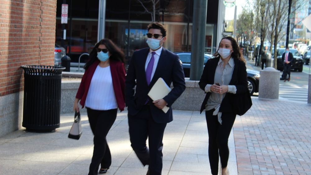 Jasiel Correia approaches the courthouse alongside his mother and fiance.