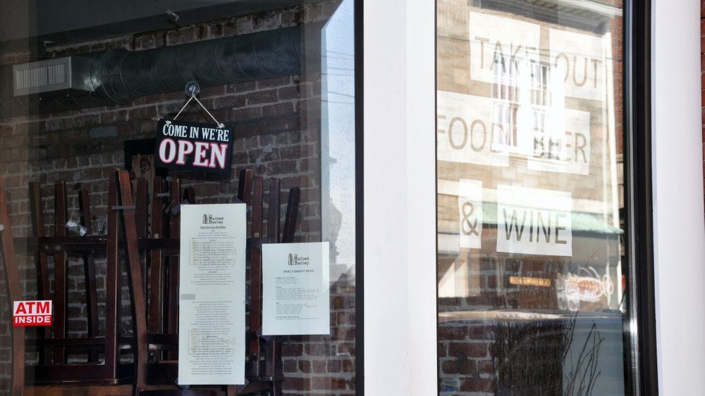 A bar in downtown Westerly advertises take out service.