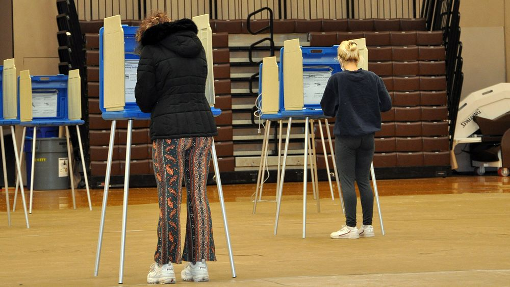 Voters cast ballots at Pizzitola Memorial Sports Center at Brown University on Nov. 3, 2020.