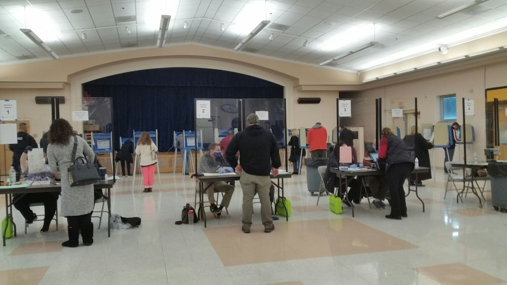 Voters cast ballots at Orchard Farms Elementary School in Cranston.