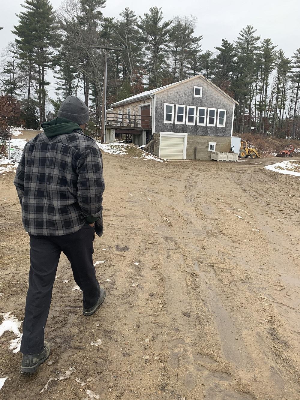 Dom Fernandes walks toward the sorting barn at Fresh Meadows Farm