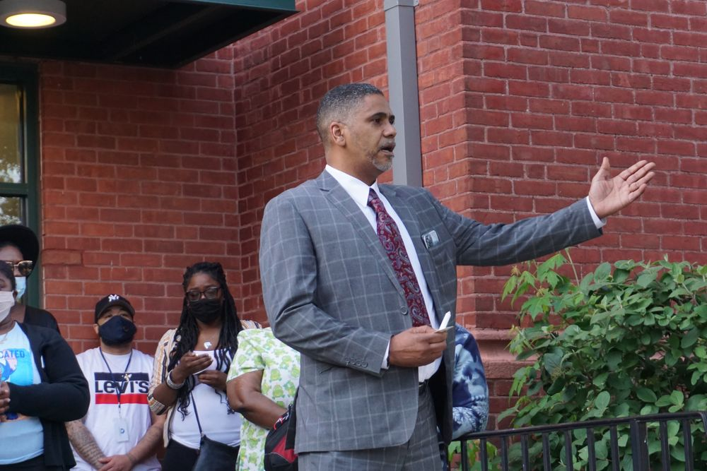 Nonviolence Institute executive director Cedric Huntley speaks during a vigil for Tatyana Francois this month.