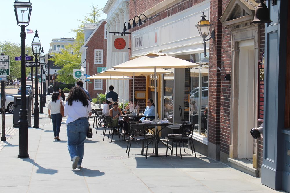 Residents dine outside in Newport, R.I. The state is lifting all restrictions on businesses starting Friday.