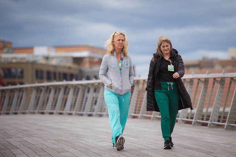 Two unmasked women on the pedestrian bridge in Providence, R.I.