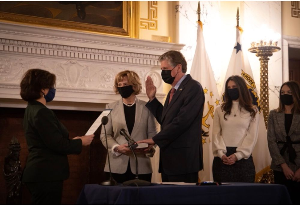 Dan McKee getting sworn in as governor by Secretary of State Nellie Gorbea