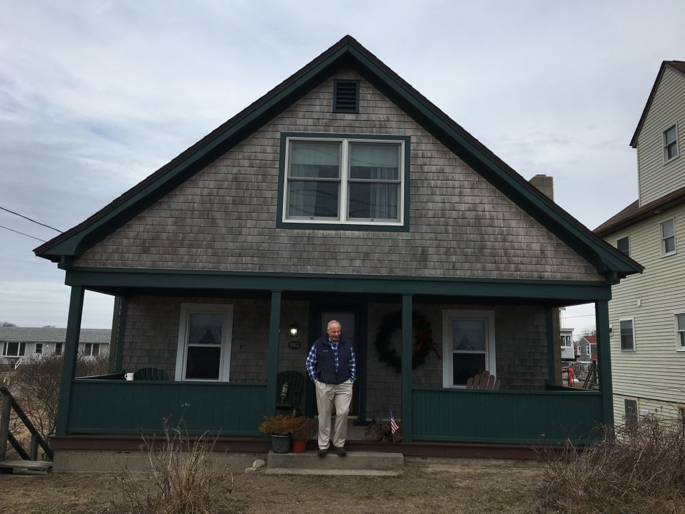 John LaCroix in front of his family's house in Matunuck. The rising cost of flood insurance has pushed him to sell.