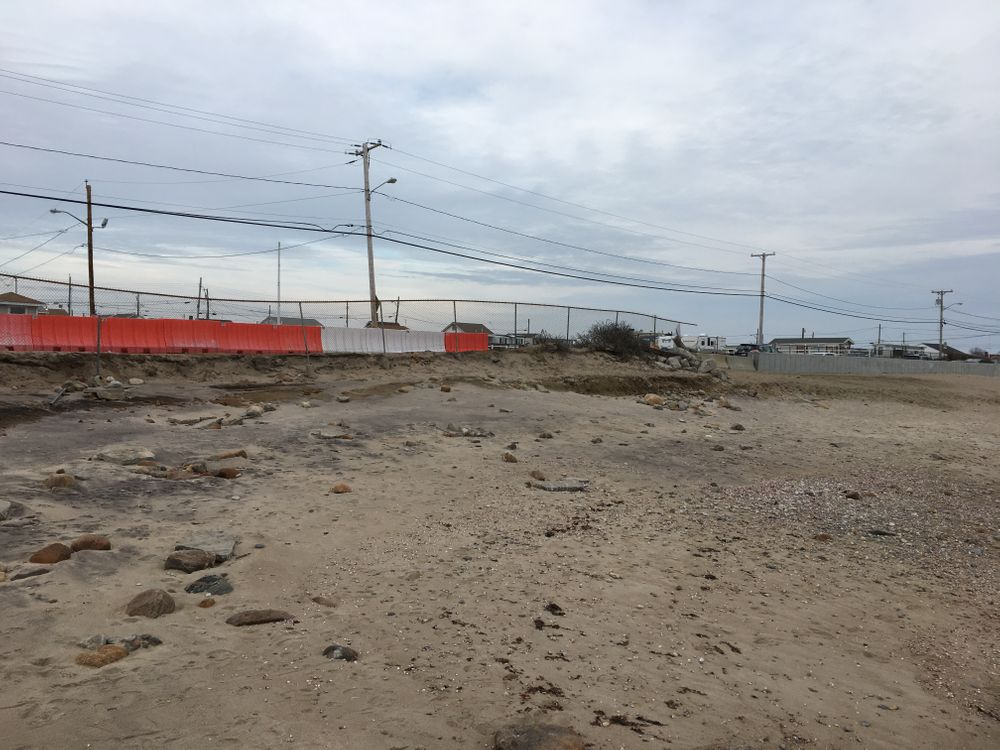 The existing seawall is visible to the far right. The town plans to extend the barrier to the left, where rapid erosion is threatening Matunuck Beach Road.
