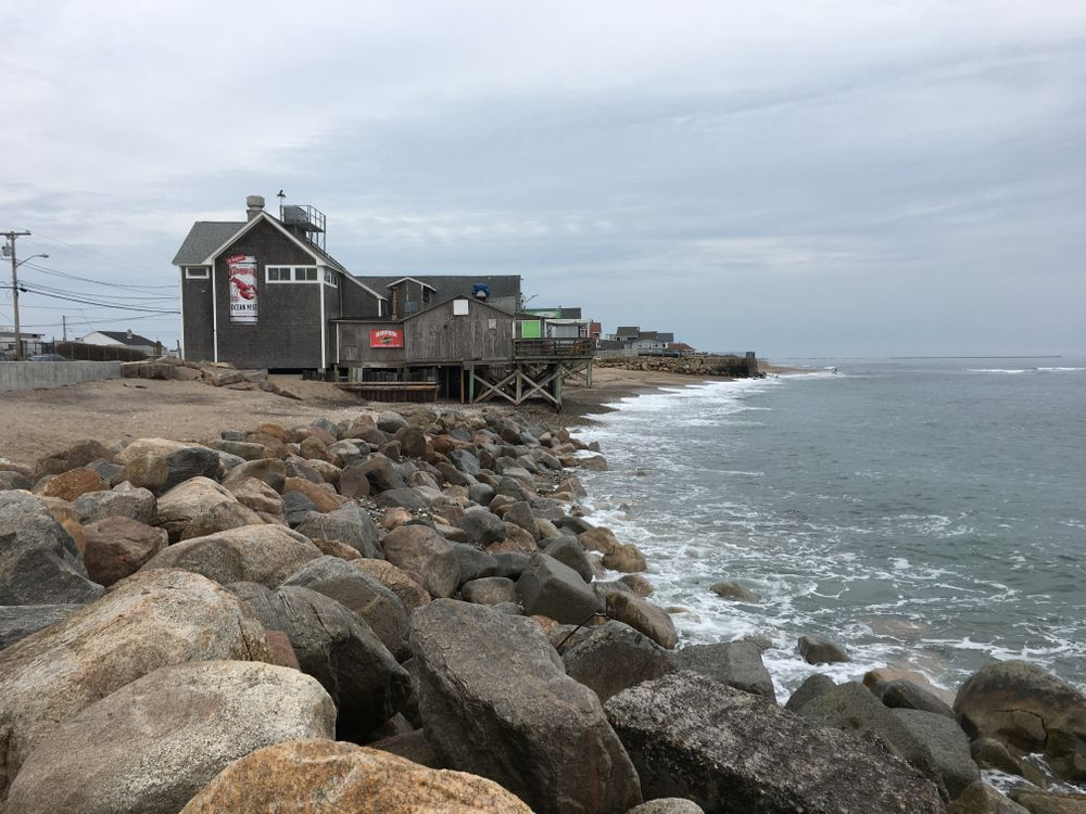 John LaCroix remembers when the beach in front of Matunuck's restaurants was wide enough to set up rows of picnic tables, or play a game of football.