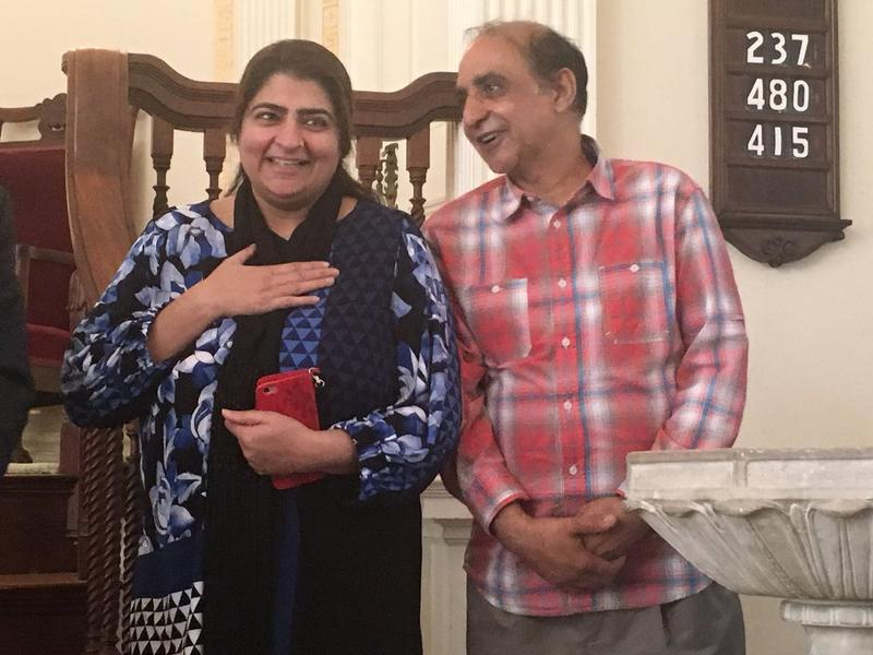Zahida Altaf and Malik Naveed bin Rehman speak to supporters inside the First United Congressional Church of Old Lyme on Tuesday, after learning that they'd been granted a stay of removal by immigration officials.