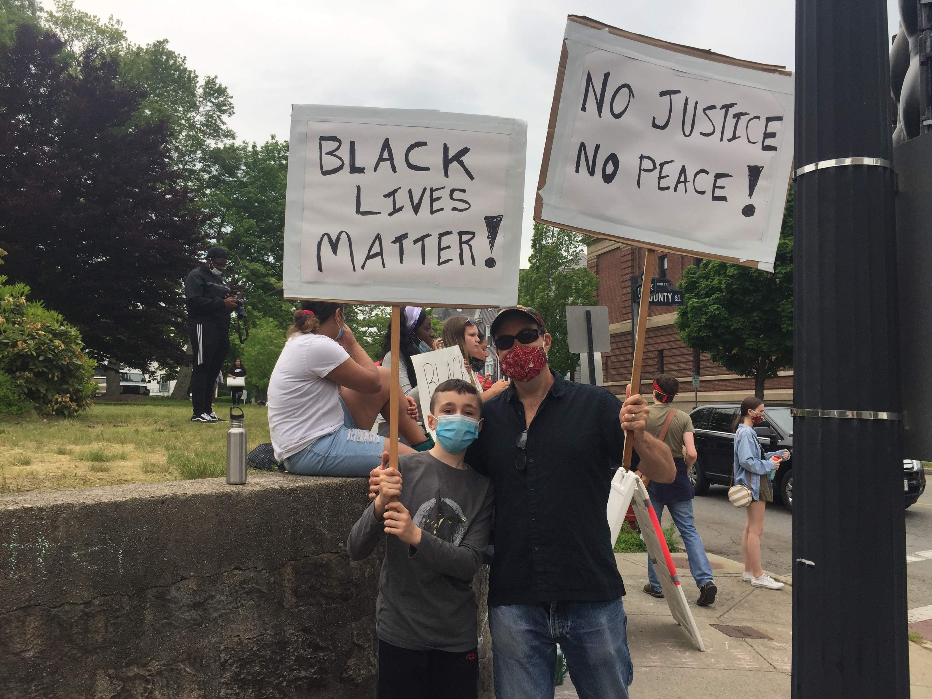 Resident Matthew Ryckebusch (right) and his son protesting in New Bedford on Wednesday.