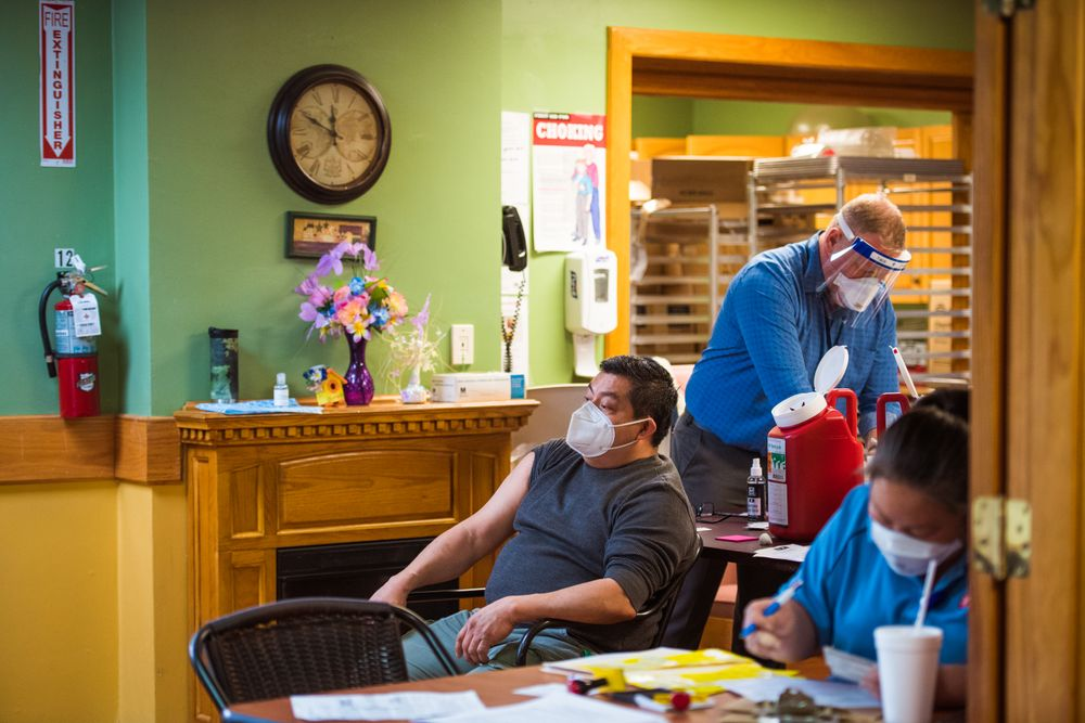 Ivan Ramirez, 52, a maintenance worker at Elmwood nursing home, waits to get a COVID-19 vaccine. Many of his friends decided to wait.