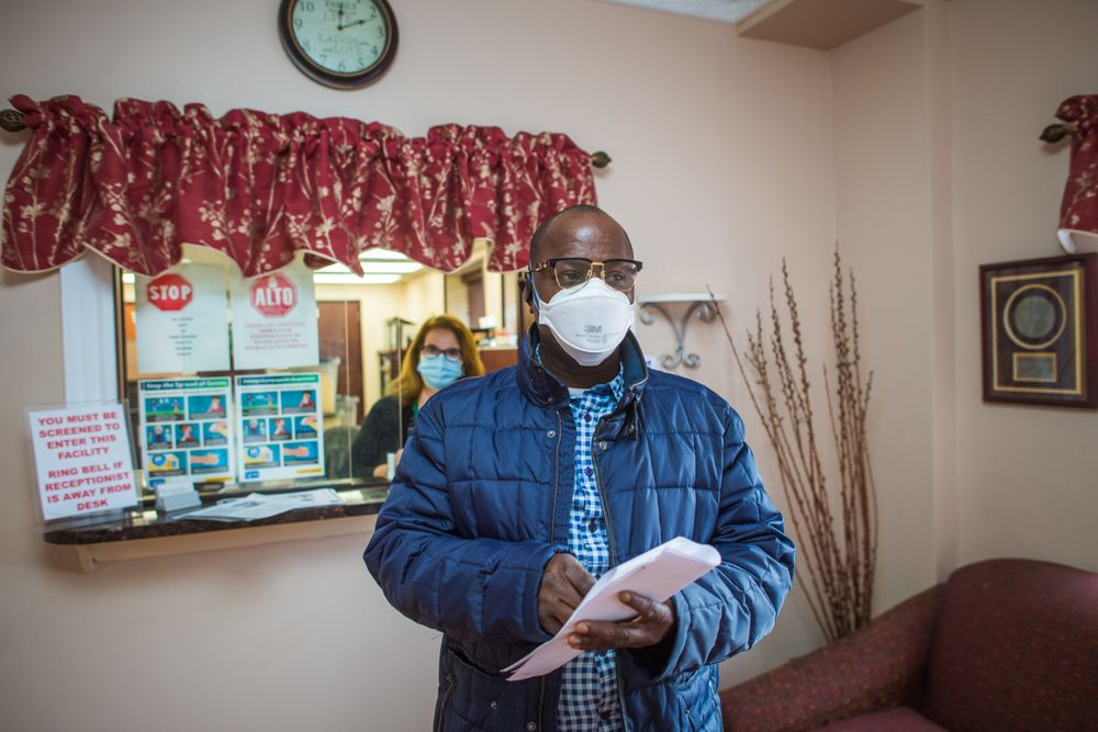 Rasaq Alabede, 51, a registered nurse who got his COVID-19 vaccine, says he hopes his co-worker at Elmwood will follow his example and get the shot.