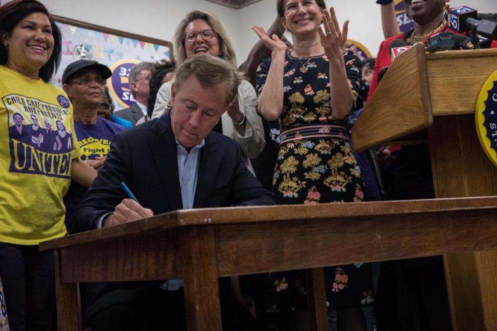 Gov. Ned Lamont signed a statewide minimum wage increase into law on May 28, 2019 at the Parkville Care Center in Hartford, Connecticut. The minimum wage will begin to rise on October 1.