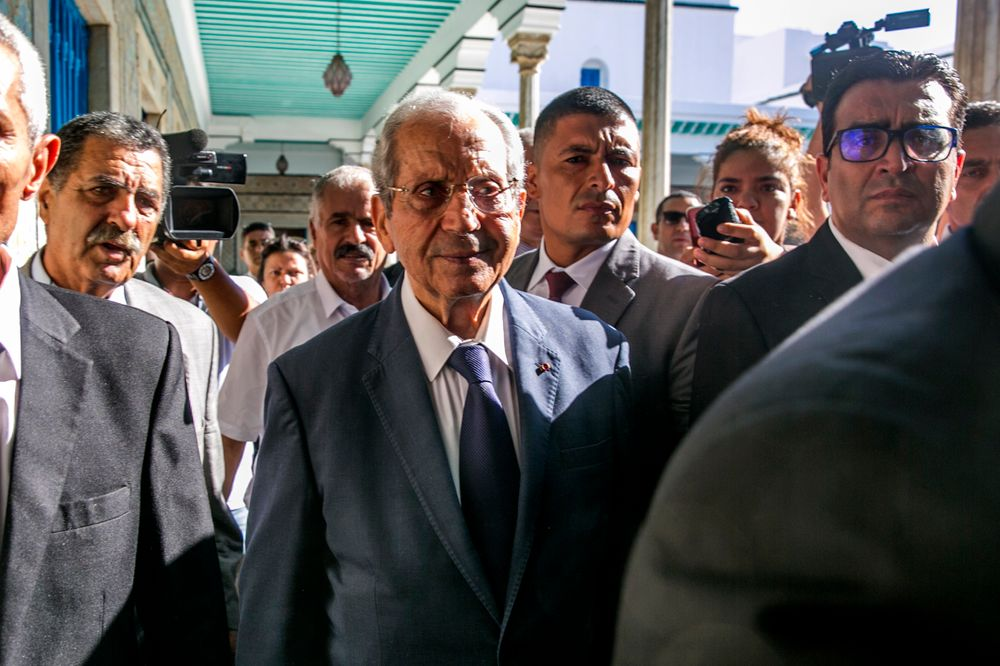 Tunisian parliament president Mohamed Ennaceur, center, arrives to be sworn in as Interim president in Tunis, Tunisia, Thursday, July 25, 2019. Ennaceur, the leader of Tunisia's parliament has been sworn in as the interim president of the North African country after 92-year-old President Beji Essebsi died in office. The state news agency TAP reported that Mohamed Ennaceur, president of the Assembly of People's Representatives, took the oath of office Thursday July 25, hours after Essebsi's death in the morning. (AP Photo/Hassene Dridi)