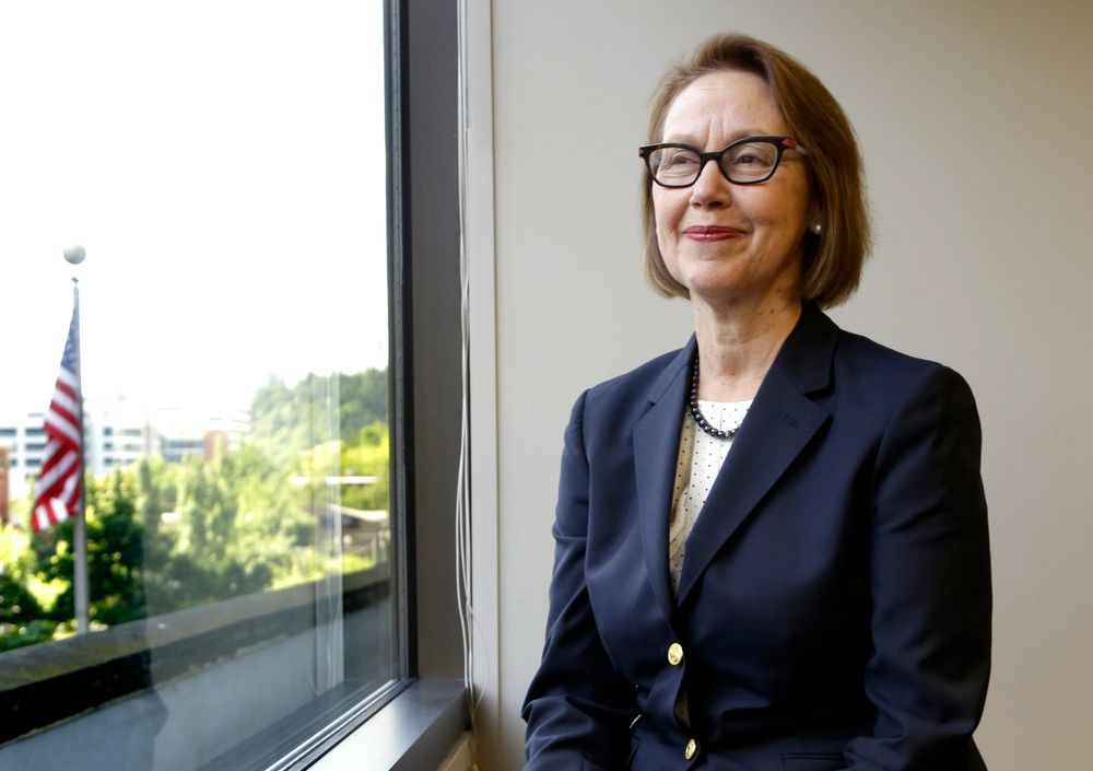 FILE - In this July 13, 2016 file photo, Oregon Attorney General Ellen Rosenblum poses for a photo at her office in Portland, Ore. Oregon's attorney general is telling the U.S. Supreme Court that Oregon's criminal justice system would be