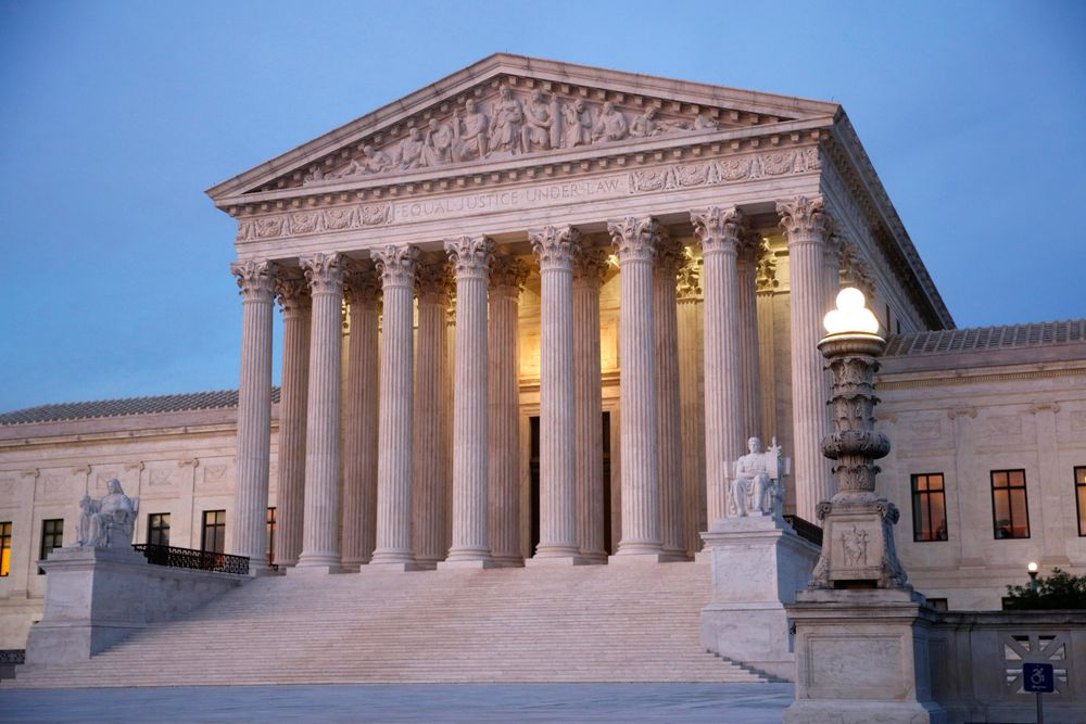 FILE - In this May 23, 2019 file photo, the U.S. Supreme Court building at dusk on Capitol Hill in Washington. Oregon's attorney general is telling the U.S. Supreme Court that Oregon's criminal justice system would be