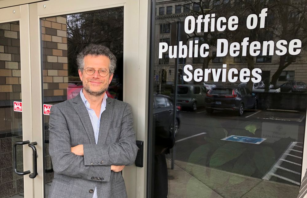FILE - In this photo taken April 12, 2019 photo, Marc Brown, a lawyer with Oregon's Office of Public Defense Services-Criminal Appeals Section, poses in Salem, Ore. Oregon's attorney general is telling the U.S. Supreme Court that Oregon's criminal justice system would be