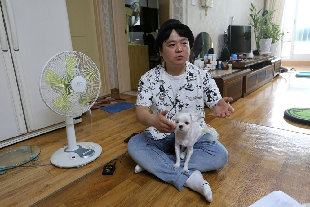 In this July 18, 2019, photo, North Korean refugee Jang Myung-jin speaks during an interview at his house in Seoul, South Korea. The 32-year-old Jang is among a handful of young North Korean refugees in South Korea who have launched YouTube channels that offer a rare glimpse into the everyday lives of people in North Korea, one of the world's most secretive and repressive countries. (AP Photo/Ahn Young-joon)