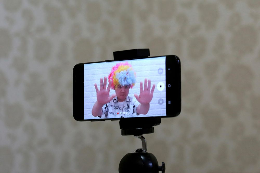 In this July 18, 2019, photo, a smartphone screen shows North Korean refugee Jang Myung-jin as he films himself in a demonstration of his YouTube broadcast during an interview at his house in Seoul, South Korea. The 32-year-old Jang is among a handful of young North Korean refugees in South Korea who have launched YouTube channels that offer a rare glimpse into the everyday lives of people in North Korea, one of the world's most secretive and repressive countries. (AP Photo/Ahn Young-joon)