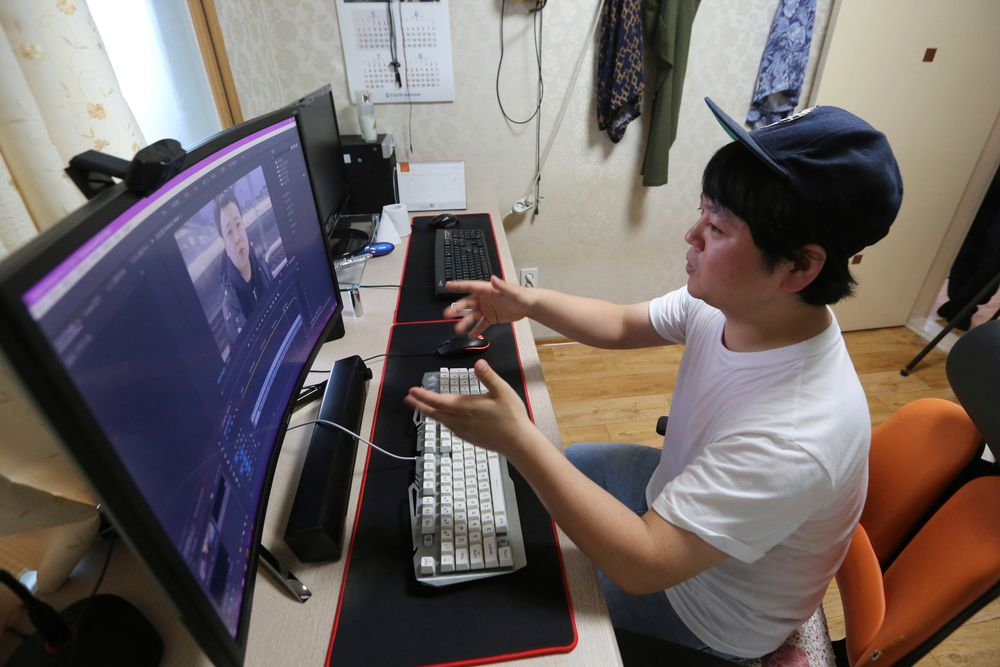 In this July 18, 2019, photo, North Korean refugee Jang Myung-jin edits his YouTube footage during an interview at his house in Seoul, South Korea. The 32-year-old Jang is among a handful of young North Korean refugees in South Korea who have launched YouTube channels that offer a rare glimpse into the everyday lives of people in North Korea, one of the world's most secretive and repressive countries. (AP Photo/Ahn Young-joon)