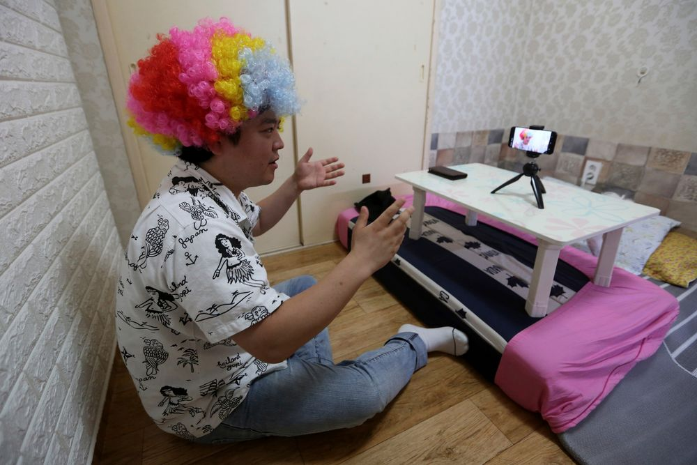 In this July 18, 2019, photo, North Korean refugee Jang Myung-jin films himself in a demonstration of his YouTube broadcast during an interview at his house in Seoul, South Korea. The 32-year-old Jang is among a handful of young North Korean refugees in South Korea who have launched YouTube channels that offer a rare glimpse into the everyday lives of people in North Korea, one of the world's most secretive and repressive countries. (AP Photo/Ahn Young-joon)