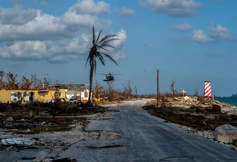 A helicopter flies over the village of High Rock after delivering emergency supplies in the aftermath of Hurricane Dorian In High Rock, Grand Bahama, Bahamas, Tuesday, September 10, 2019. (AP Photo / Ramon Espinosa)