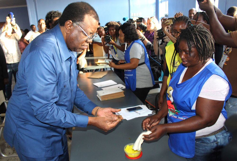 Namibian President Hage Geingob casts his ballot in Windhoek, Namibia in the country's elections Wednesday, Nov. 27, 2019. Geingob's ruling party faces its biggest challenge since independence nearly three decades ago. The resource-rich southern African nation's registered 1.3 million voters are voting for president and National Assembly members. (AP Photo/Brandon van Wyk)
