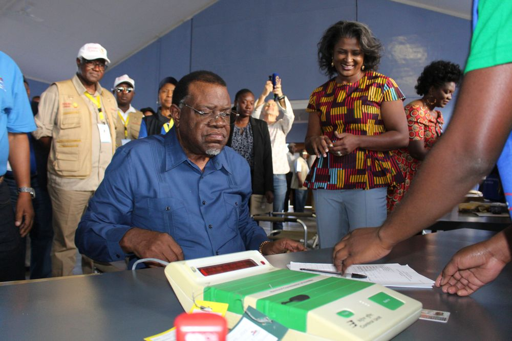 Namibian President Hage Geingob prepares to cast his vote in Windhoek, Namibia, in the country's elections Wednesday, Nov. 27, 2019. Geingob's ruling party faces its biggest challenge since independence nearly three decades ago. The resource-rich southern African nation's registered 1.3 million voters are voting for president and National Assembly members. (AP Photo/Brandon van Wyk)
