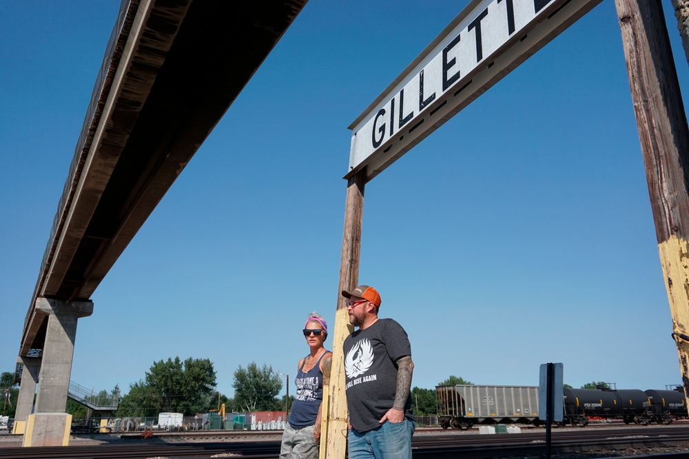 In this Thursday, Sept. 5, 2019 photo shows warehouse technician Melissa Worden, left, and heavy equipment operator Rory Wallet, in downtown Gillette, Wyo. The shutdown of Blackjewel LLC's Belle Ayr and Eagle Butte mines in Wyoming since July 1, 2019, has added yet more uncertainty to the Powder River Basin's struggling coal economy. Both Worden and Wallet wonder if they will get their old jobs back. (AP Photo/Mead Gruver)