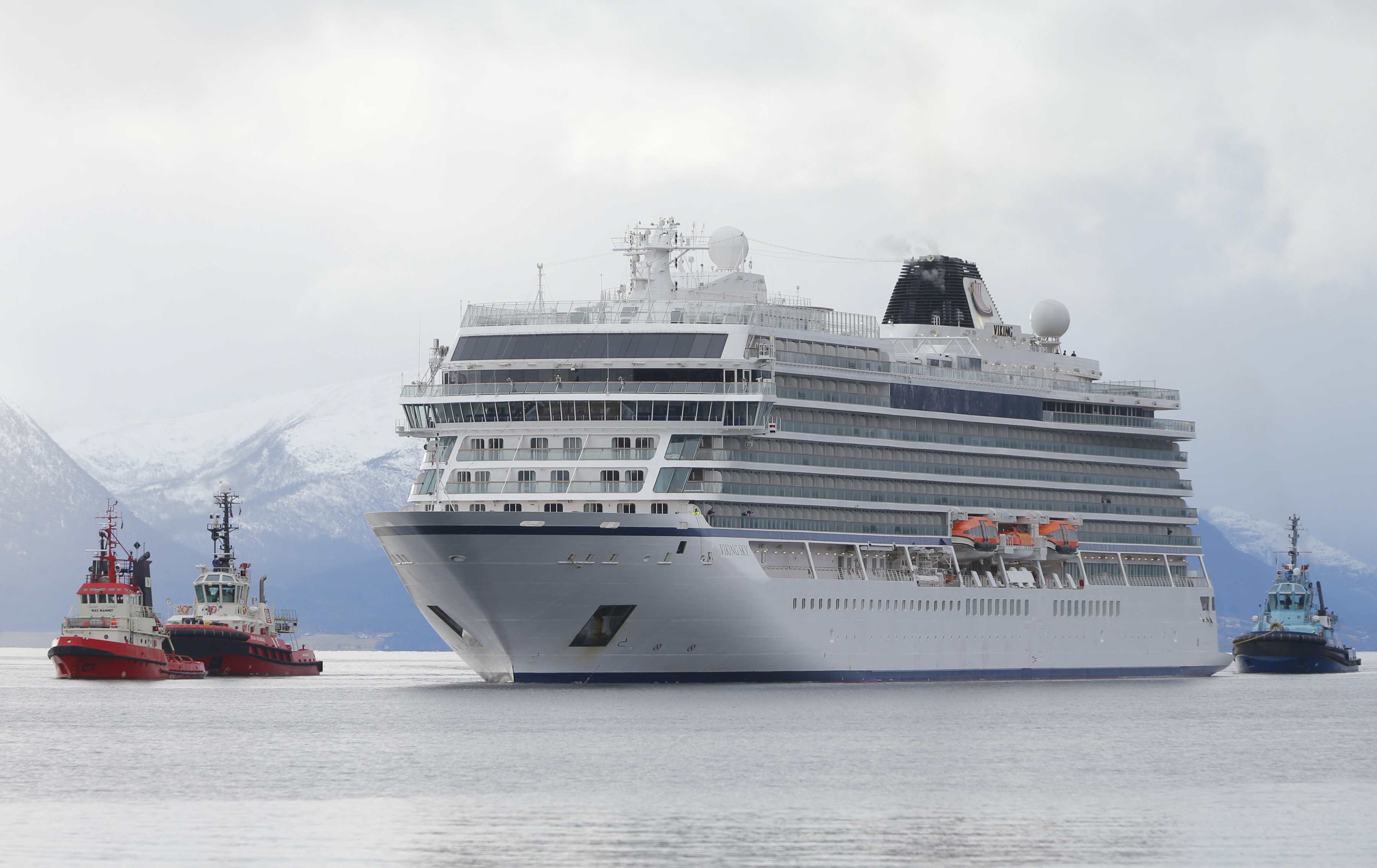 The cruise ship Viking Sky arrives at port off Molde, Norway, Sunday March 24, 2019, after the problems in heavy seas off Norway's western coast. Rescue helicopters took more than 475 passengers from a cruise ship that got stranded off Norway's western coast in bad weather before the vessel departed for a nearby port under escort and with nearly 900 people still on board, the ship's owner said Sunday. (Svein Ove Ekornesvag/NTB scanpix via AP)