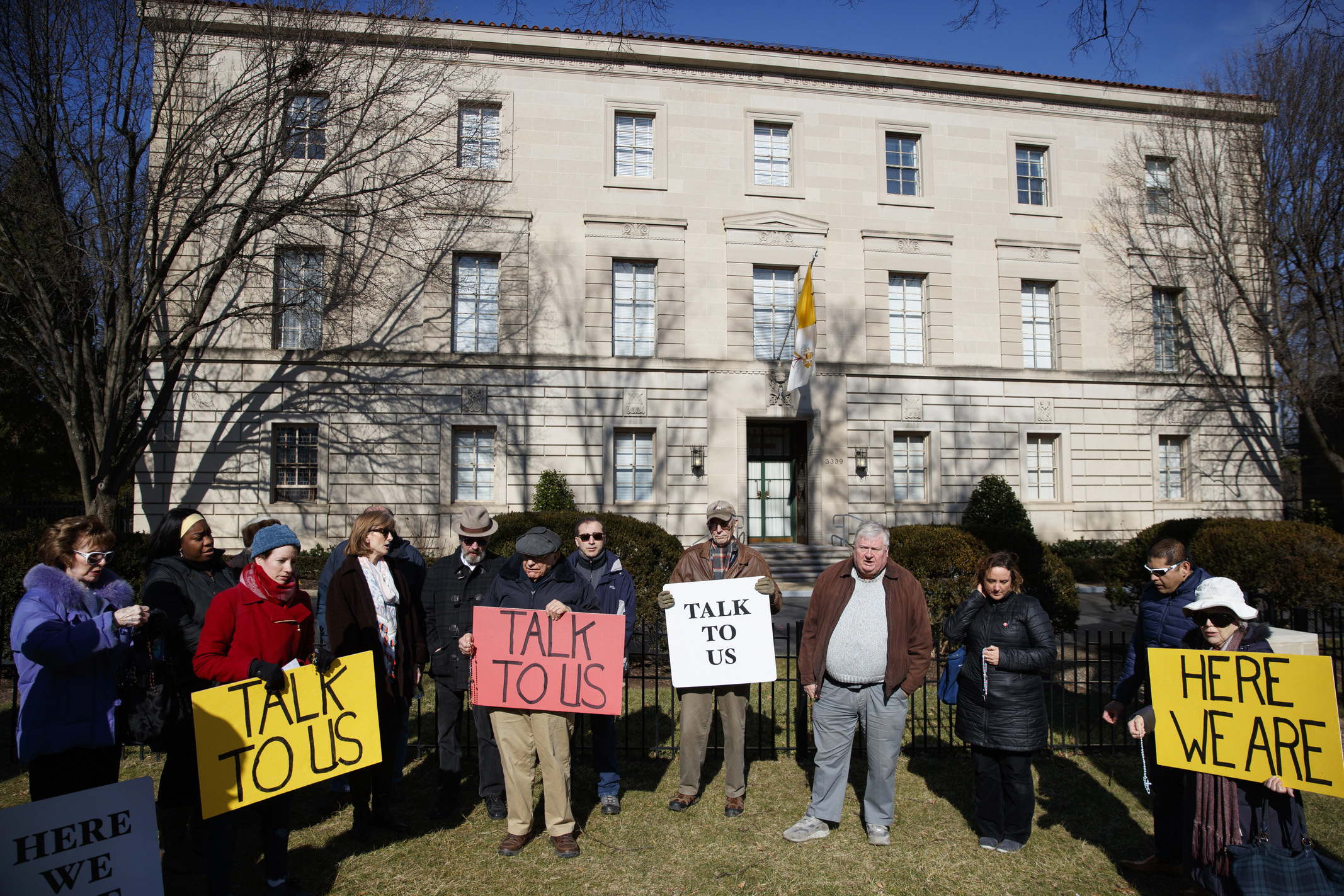FILE - In this Feb. 16, 2019 file photo, a group with Catholic Laity for Orthodox Bishops and Reform gathers to pray the rosary outside the Apostolic Nunciature of the Holy See in Washington. Pope Francis' high-stakes sex abuse prevention summit is meant to call attention to the crisis as a global problem that requires a global response. After the abuse scandal erupted in Boston in 2002, U.S. bishops adopted the toughest anti-abuse norms in the Catholic Church, a