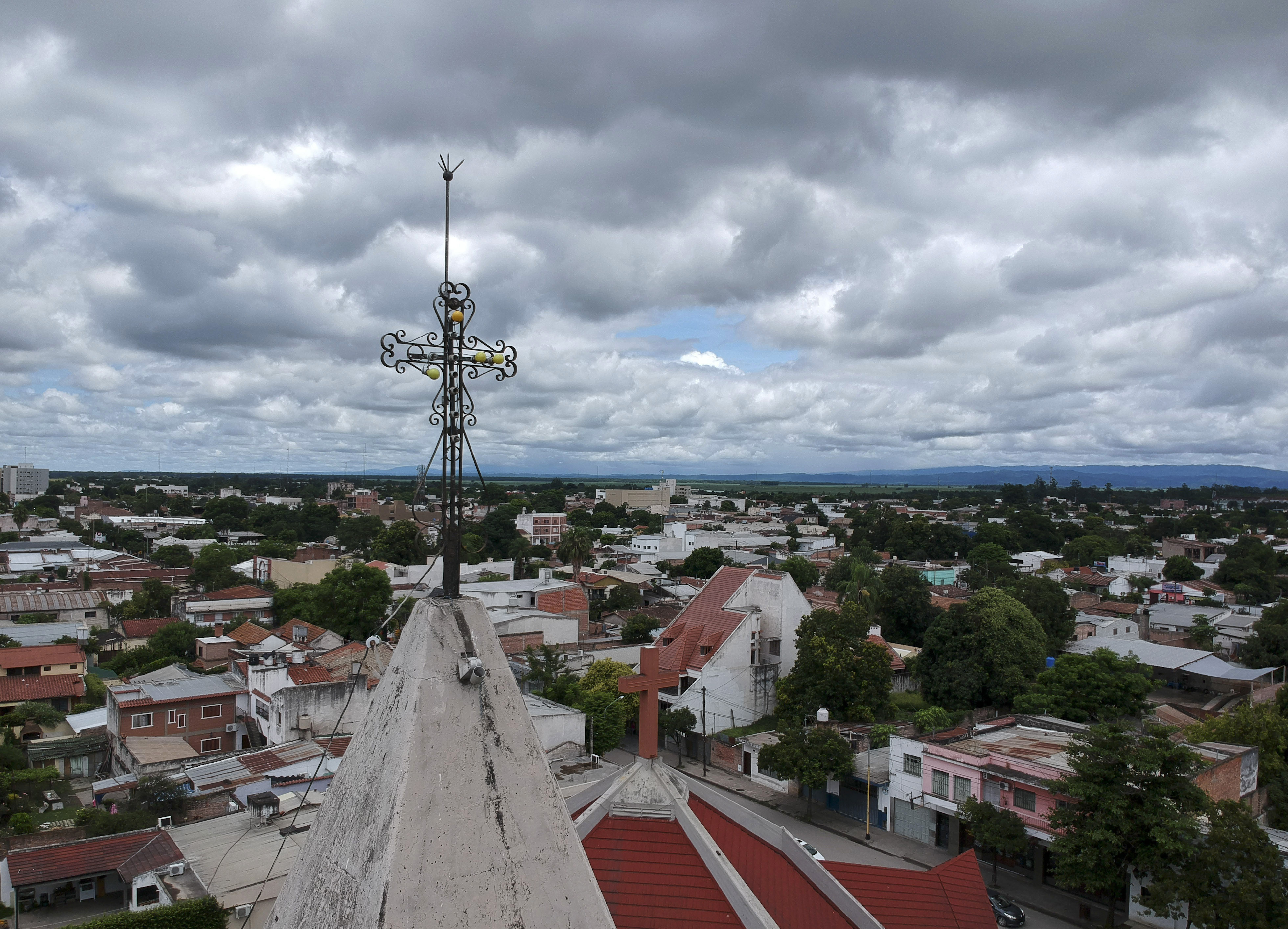 FILE - This Jan. 16, 2019 photo shows Oran city, Argentina. Pope Francis' high-stakes sex abuse prevention summit is meant to call attention to the crisis as a global problem that requires a global response. Francis' home country is beginning to see an eruption of the scandal, with some cases even implicating the pontiff himself. (AP Photo/Natacha Pisarenko, file)