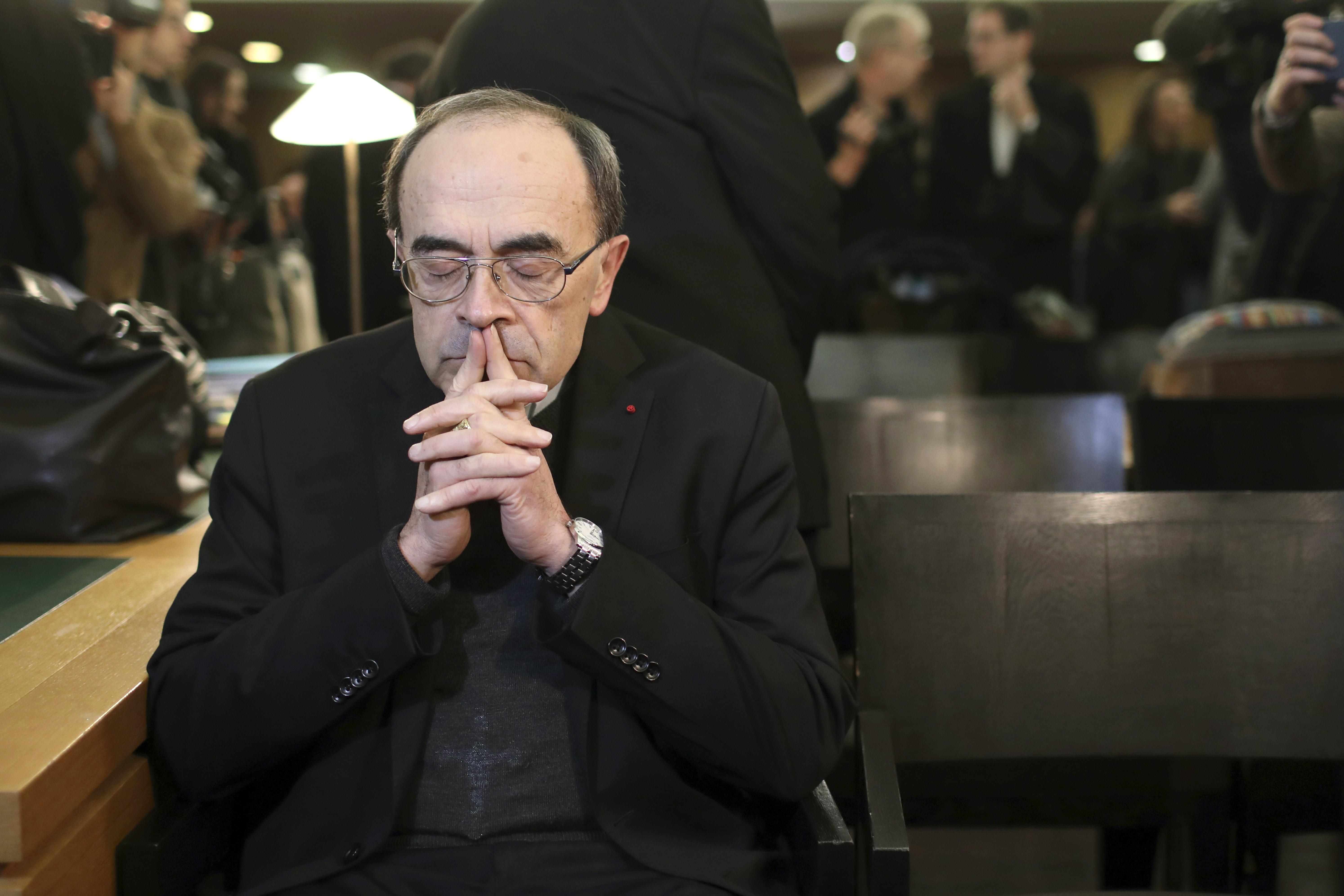 FILE - In this Jan. 7, 2019 file photo, French Cardinal Philippe Barbarin waits for the start of his trial at the Lyon courthouse, central France. Pope Francis' high-stakes sex abuse prevention summit is meant to call attention to the crisis as a global problem that requires a global response. One of France's most prominent cardinals, Philippe Barbarin, went on trial earlier this year on charges he covered up for a known pedophile. (AP Photo/Laurent Cipriani, File)