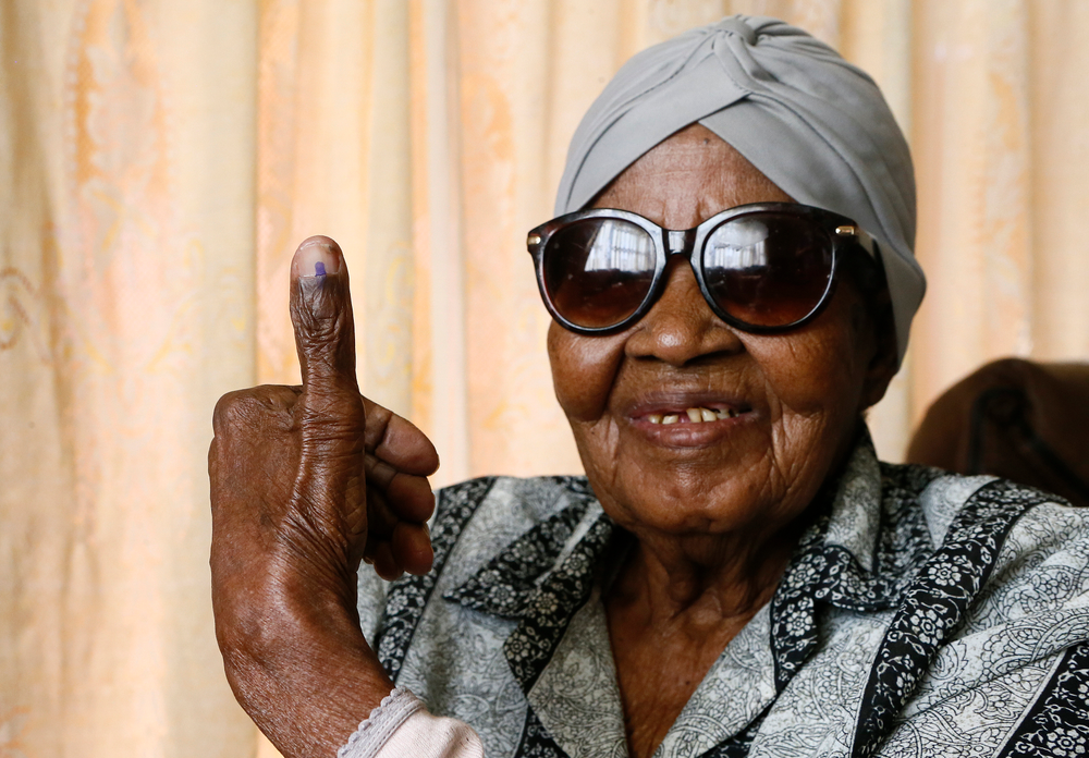 108-year-old MMaphuti Mabitsela shows her marked thumb nail after casting her special vote, at her home in Atteridgeville, near Pretoria, South Africa on Monday May 6, 2019. Mabitsela took part in South Africa's special voting for the elderly and infirm where electoral officials go to their homes or care facilities before the actual voting day of May 8. (AP Photo/Phill Magakoe)