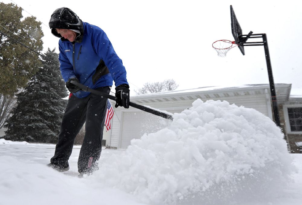 Kenny Stuyvenberg shovels his driveway as the latest round of winter weather moves through the Fox Cities on Wednesday, November 13, 2019, in Kimberly, Wis. (Wm. Glasheen/The Post-Crescent via AP)