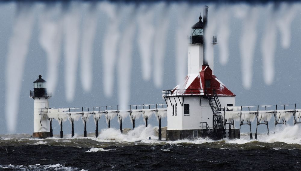 Snow and ice accumulates on the St. Joseph Lighthouses, Tuesday, Nov. 12, 2019, as a fall snow storm moves through St. Joseph, Mich. (Don Campbell/The Herald-Palladium via AP)