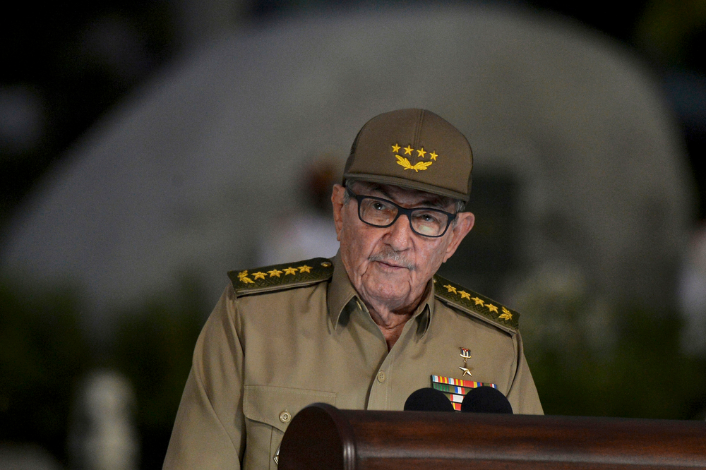 FILE - In this  Jan. 1, 2019 file photo, Cuba's First Secretary of Communist Party Raul Castro gives a speech during the celebration of 60th Anniversary of Cuban Revolution, in Santiago de Cuba, Cuba. Castro warned Cubans on Wednesday, April 10, 2019, to brace for shortages and other economic problems due to Trump administration policies, but says the island won't repeat the extreme deprivation of the post-Soviet period, in his first speech to the nation in more than three months. (AP Photo/Yamil Lage, File)