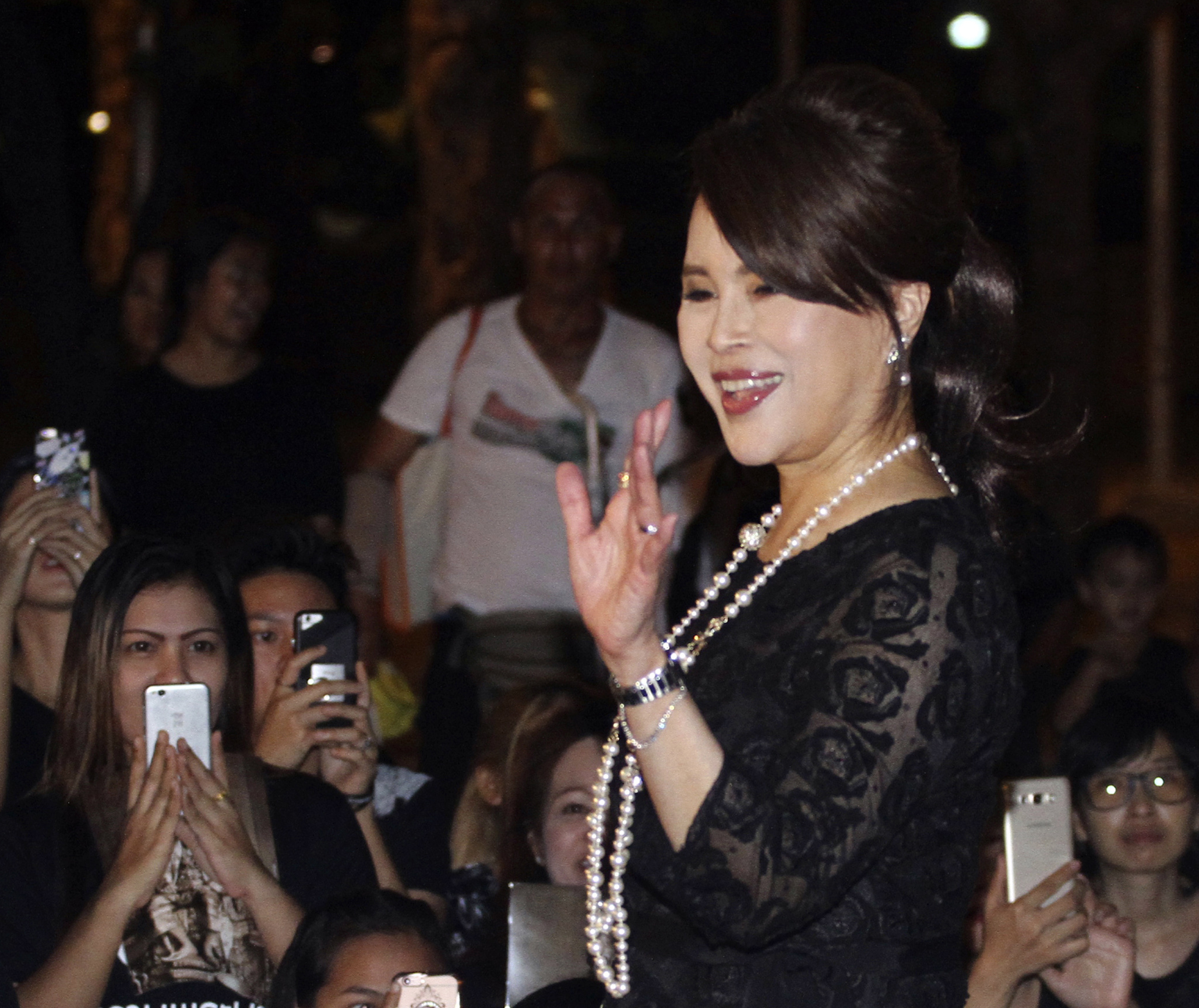 In this Oct 27, 2017, photo, Thai Princess Ubolratana Mahidol waves to Thai people outside Grand Palace in Bangkok , Thailand. The selection of the elder sister of Thailand's king as a political party nominee for prime minister has upended a tradition of the palace playing no public role in politics. Most but not all modern monarchies steer clear of direct involvement in electoral politics or governing. (AP Photo)