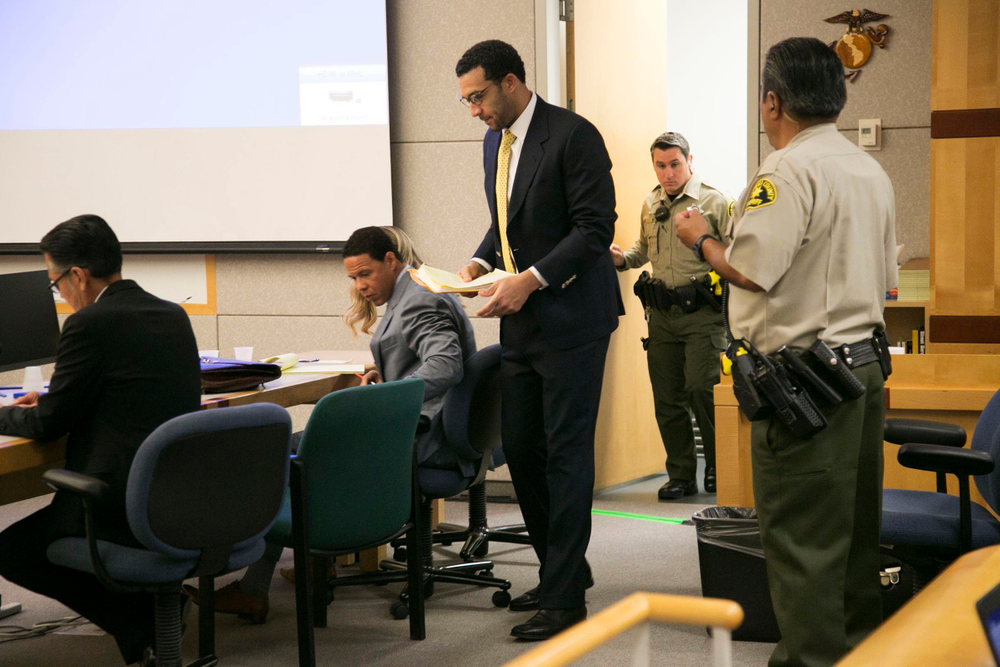 Former NFL football player Kellen Winslow Jr., standing center, takes his seat in the courtroom on the first day of his rape trial, Monday May 20, 2019, in Vista, Calif. (John Gibbins/The San Diego Union-Tribune via AP, Pool)