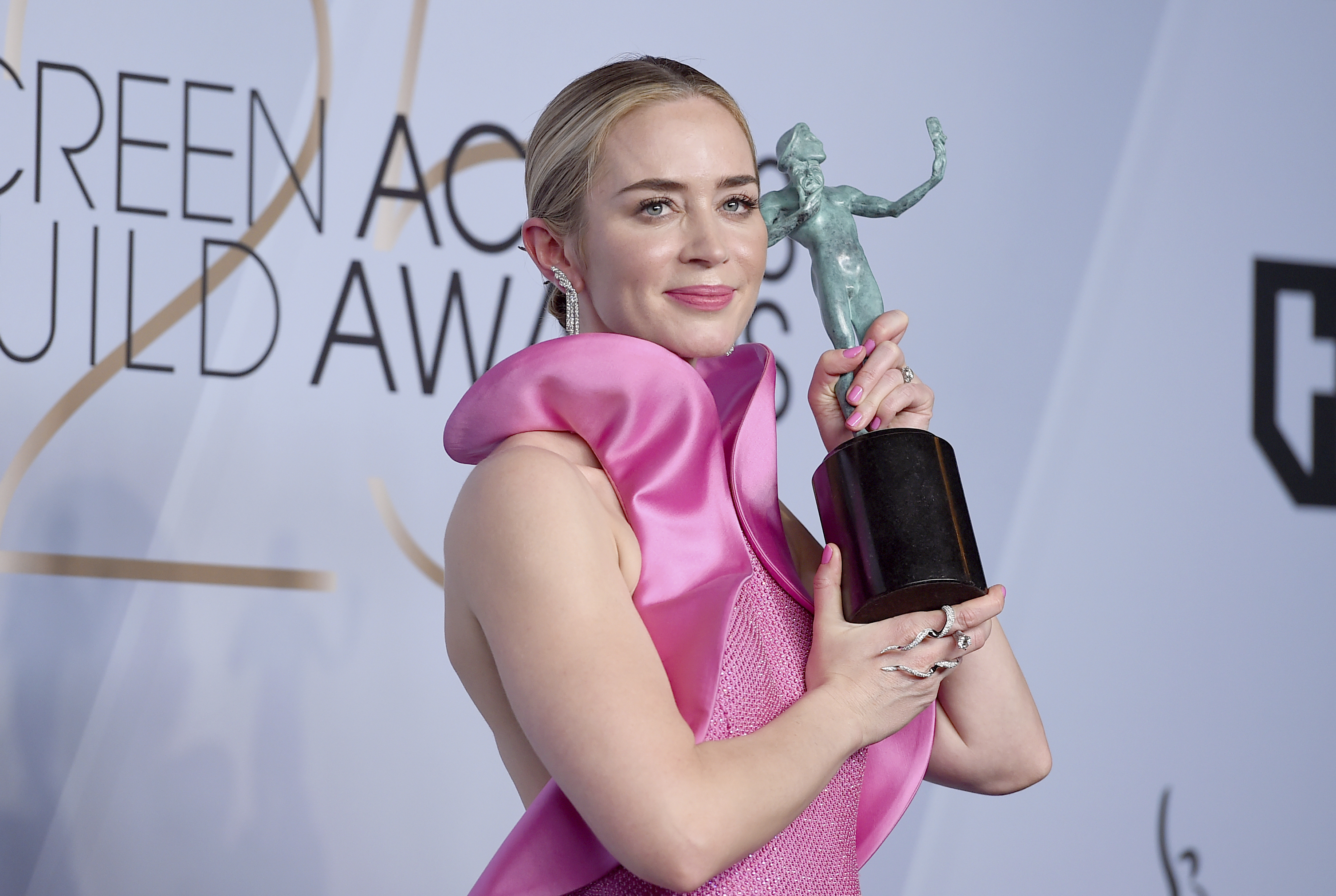 Emily Blunt poses with the award for outstanding performance by a female actor in a supporting role for