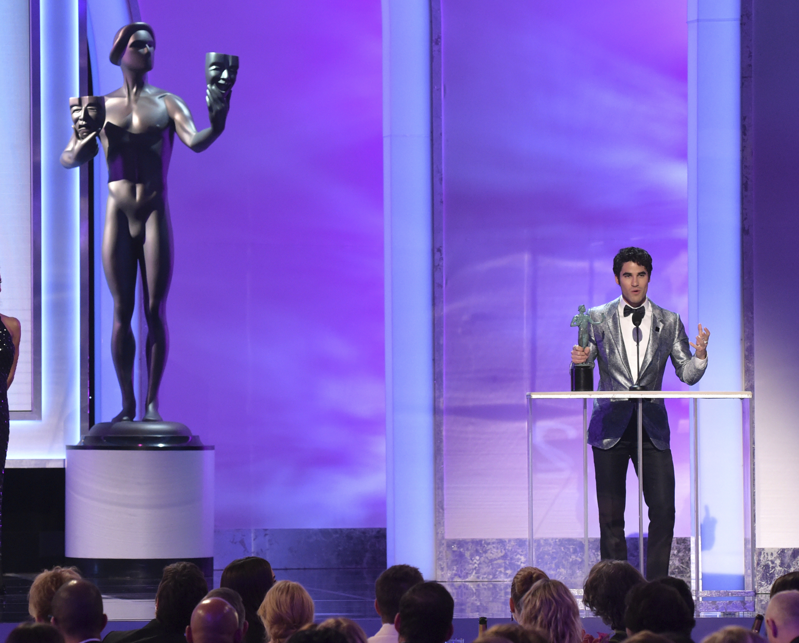 Darren Criss accepts the award for outstanding performance by a male actor in a television movie or limited series for
