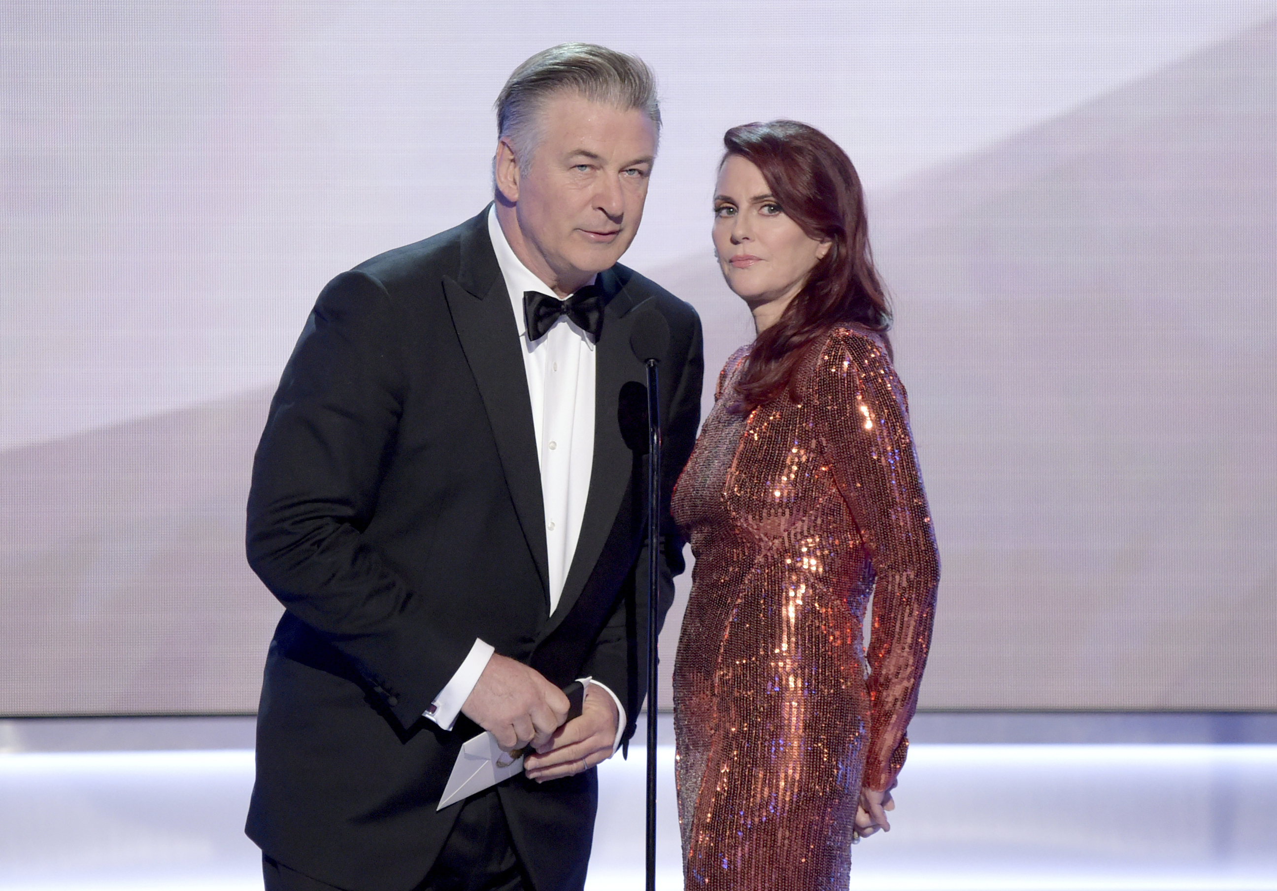Alec Baldwin, left, and Megan Mullally present the award for outstanding performance by a male actor in a comedy series at the 25th annual Screen Actors Guild Awards at the Shrine Auditorium & Expo Hall on Sunday, Jan. 27, 2019, in Los Angeles. (Photo by Richard Shotwell/Invision/AP)