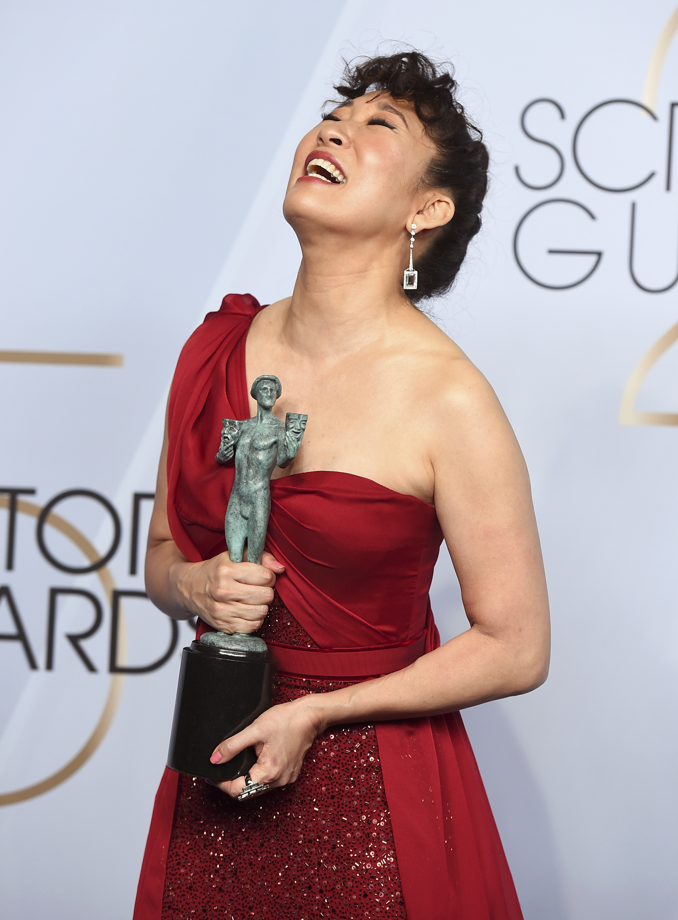 Sandra Oh poses with the award for outstanding performance by a female actor in a drama series for