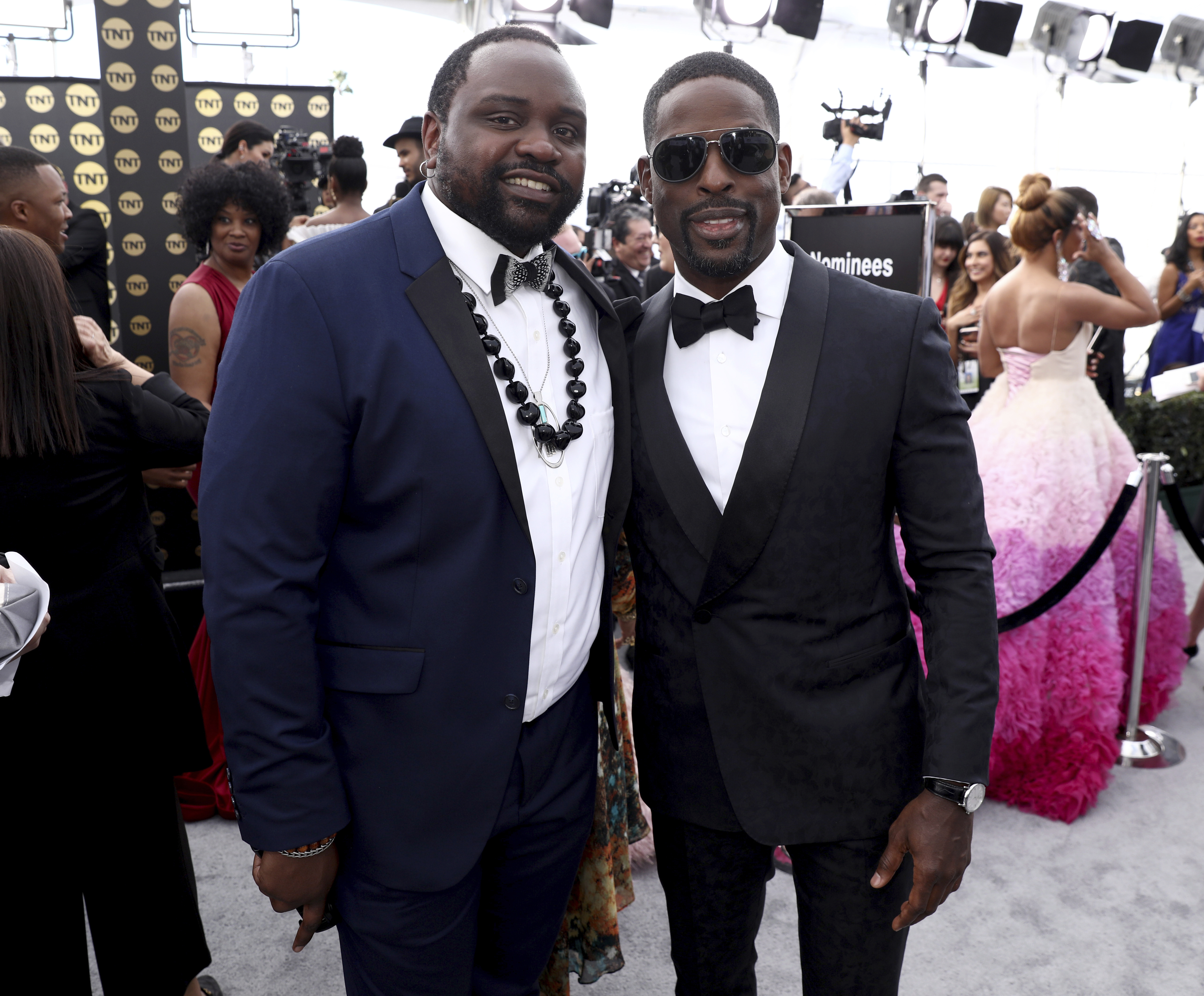 Brian Tyree Henry, left, and Sterling K. Brown arrive at the 25th annual Screen Actors Guild Awards at the Shrine Auditorium & Expo Hall on Sunday, Jan. 27, 2019, in Los Angeles. (Photo by Matt Sayles/Invision/AP)