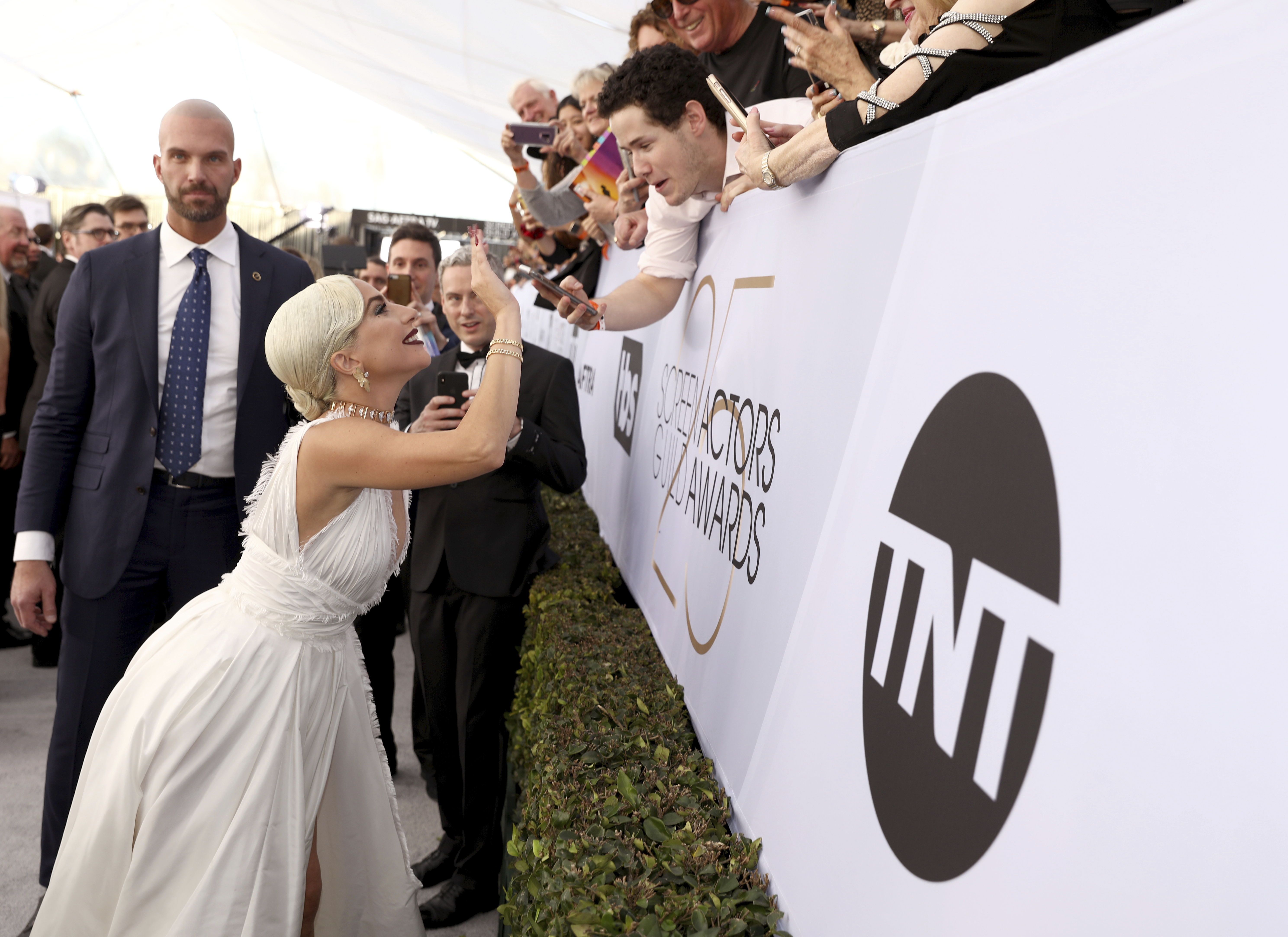 Lady Gaga interacts with fans at the 25th annual Screen Actors Guild Awards at the Shrine Auditorium & Expo Hall on Sunday, Jan. 27, 2019, in Los Angeles. (Photo by Matt Sayles/Invision/AP)