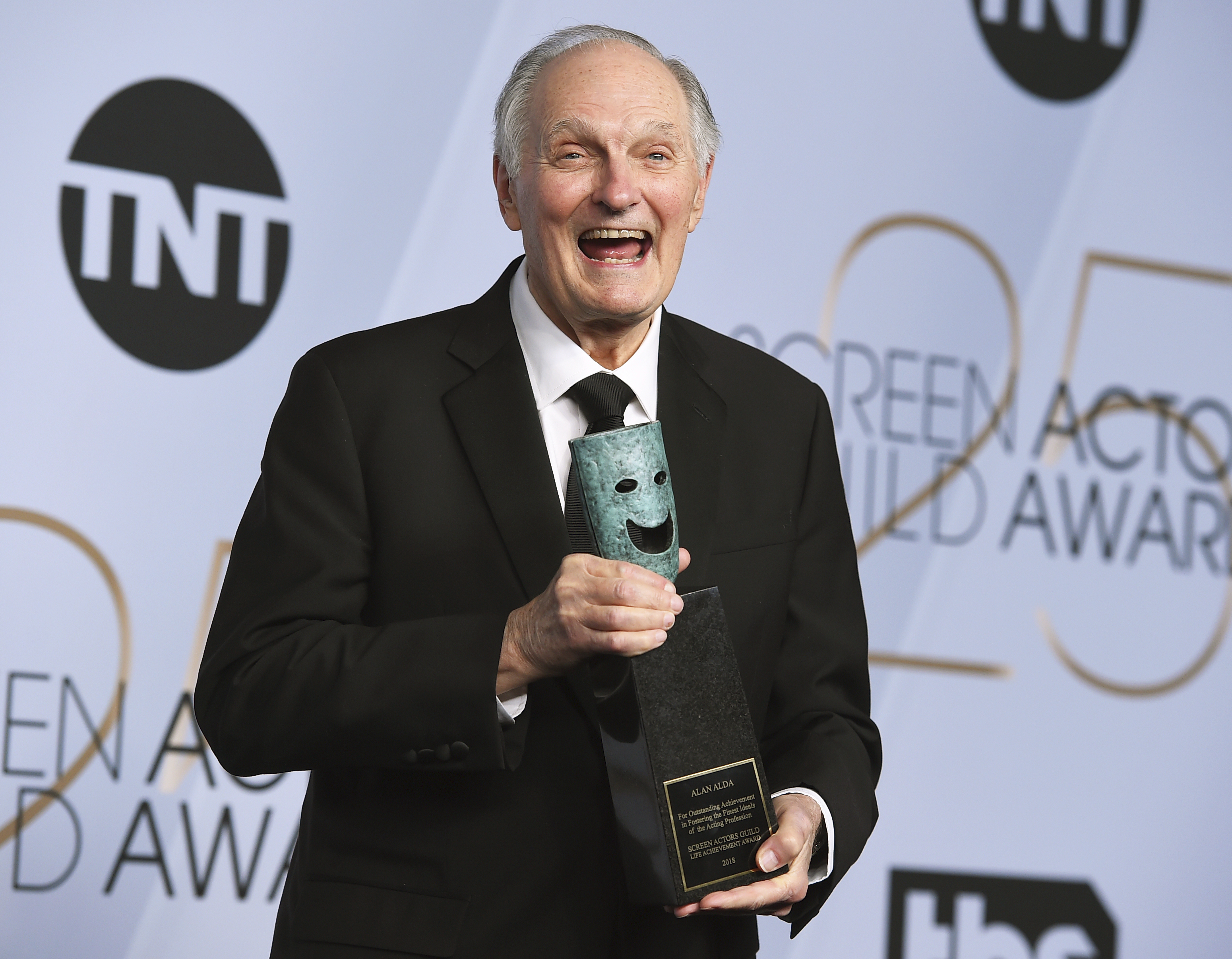 Alan Alda poses with the Life Achievement Award in the press room at the 25th annual Screen Actors Guild Awards at the Shrine Auditorium & Expo Hall on Sunday, Jan. 27, 2019, in Los Angeles. (Photo by Jordan Strauss/Invision/AP)