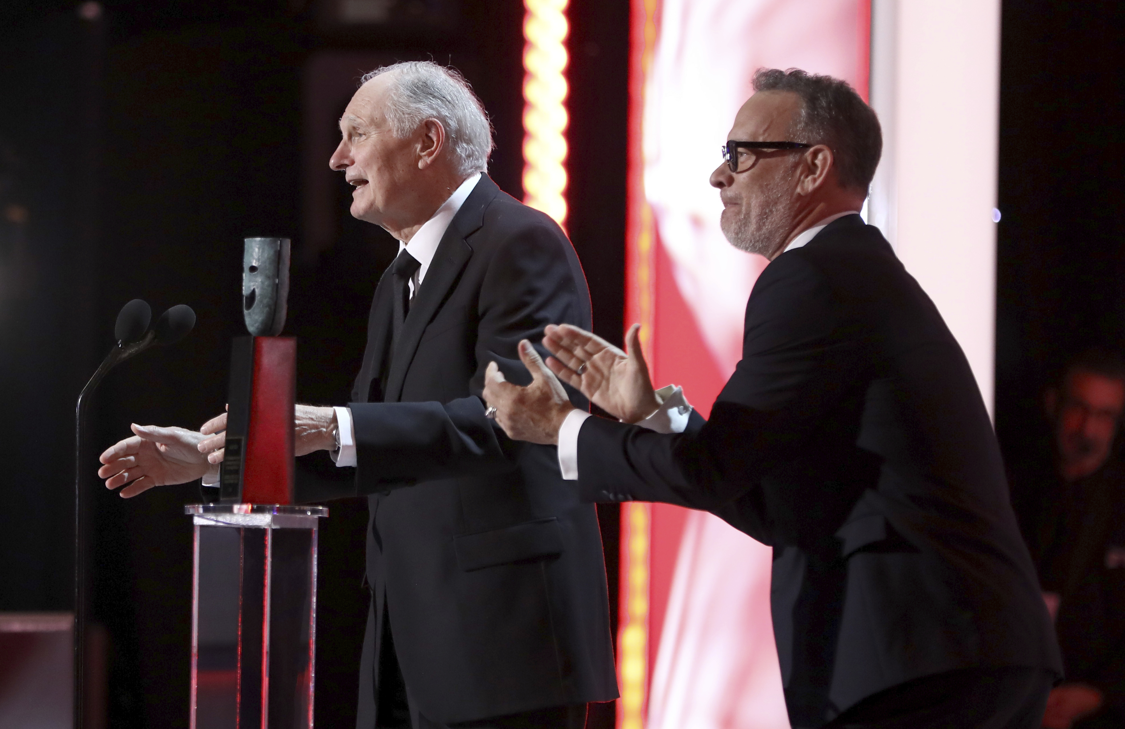 Alan Alda, left, accepts the Life Achievement award while Tom Hanks applauds at the 25th annual Screen Actors Guild Awards at the Shrine Auditorium & Expo Hall on Sunday, Jan. 27, 2019, in Los Angeles. (Photo by Matt Sayles/Invision/AP)