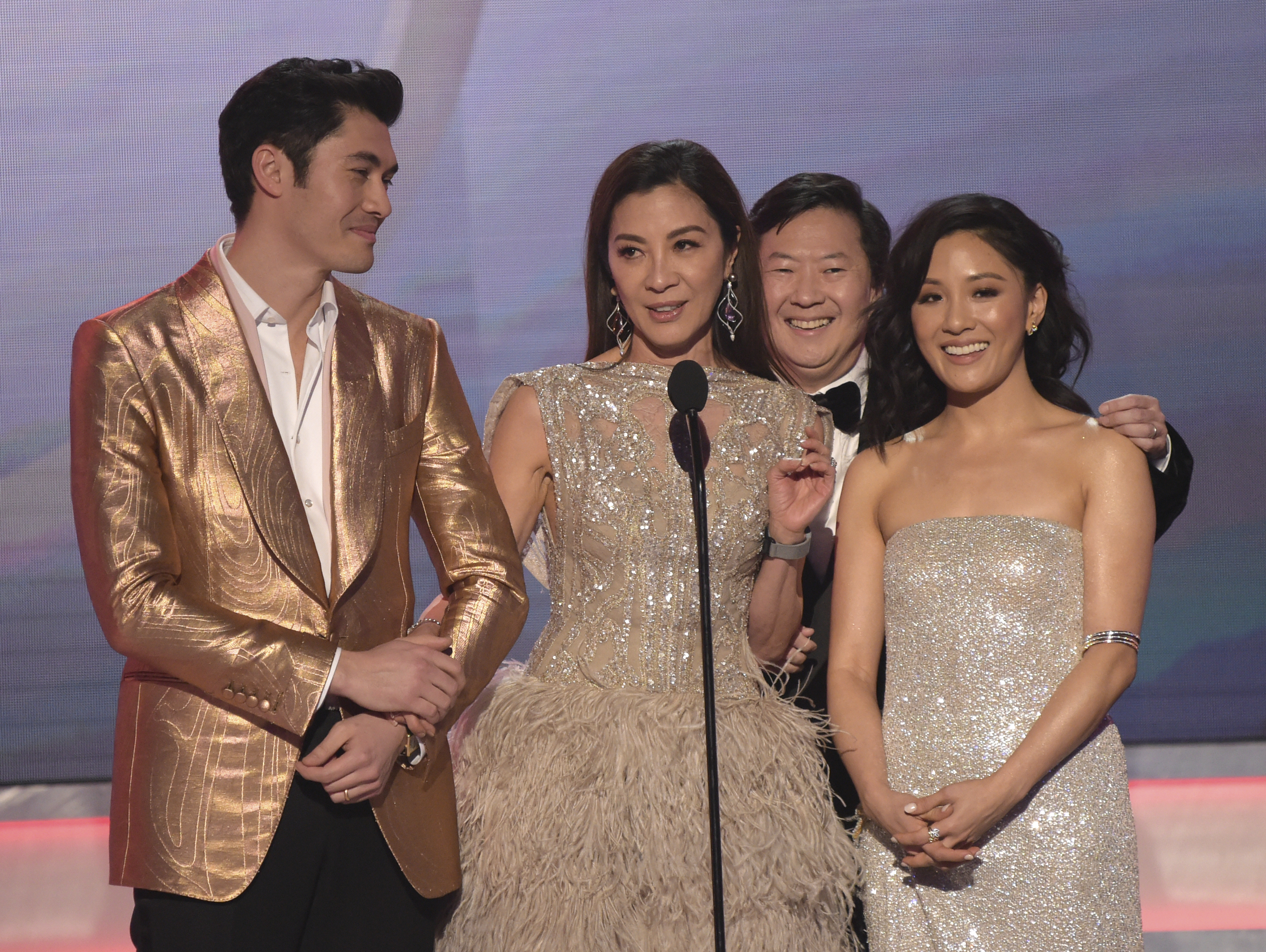 Henry Golding, from left, Michelle Yeoh, Ken Jeong and Constance Wu, nominated for outstanding performance by a cast in a motion picture, introduce a clip from their film