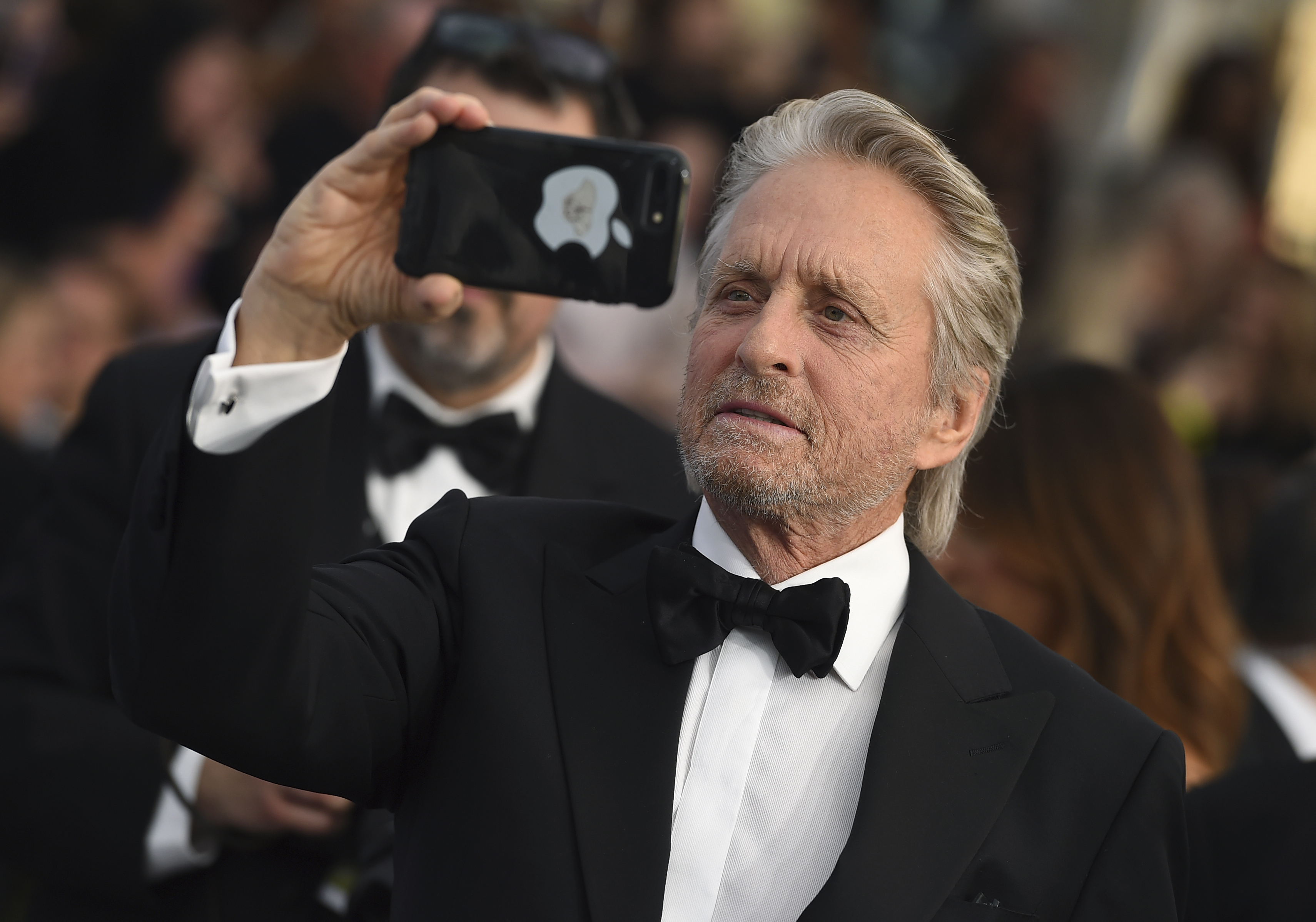 Michael Douglas takes a photo at the 25th annual Screen Actors Guild Awards at the Shrine Auditorium & Expo Hall on Sunday, Jan. 27, 2019, in Los Angeles. (Photo by Jordan Strauss/Invision/AP)